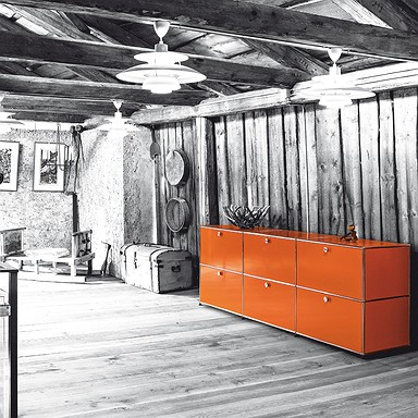 Orange sideboard in wooden cabin